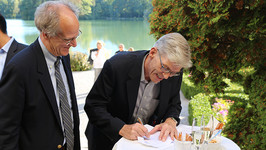 Stephen Salyer and Jochen Fried officially sign the GCA into being at a celebratory ceremony at Schloss Leopoldskron