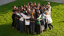 Fellows come together for a group hug during last year's program of the Salzburg Global Forum for Young Cultural Innovators