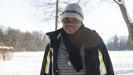 William Chilufya enjoying his first time in the snow at Session 559 Hooked on Health Care: Designing Systems for Better Health.